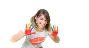 Young smiling girl painting Stock Photos