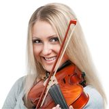 Young smiling girl playing the violin stock photography