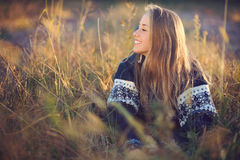Young smiling girl posing in a field Royalty Free Stock Images