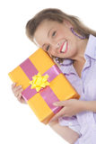 Young smiling girl with present Royalty Free Stock Image