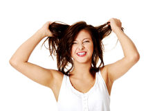 Young smiling girl pulling her hair. Royalty Free Stock Photos