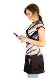 Young smiling girl read SMS. Isolate on white Stock Photos