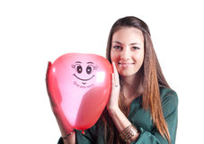 Young smiling girl with red air balloon on white Royalty Free Stock Images
