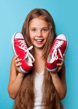 Young smiling girl with red gumshoes Royalty Free Stock Photos