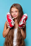 Young smiling girl with red gumshoes Stock Photography