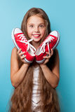 Young smiling girl with red gumshoes stock image