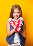 Young smiling girl with red gumshoes royalty free stock photo