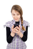 Young Smiling Girl Sending Text Message on Her Cell Phone Isolated on White Royalty Free Stock Photography