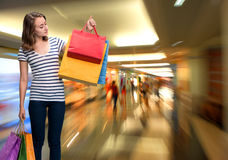 Young smiling girl with shopping bags Royalty Free Stock Images