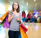 Young smiling girl with shopping bags Royalty Free Stock Image