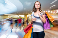 Young smiling girl with shopping bags Royalty Free Stock Photos