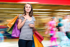 Young smiling girl with shopping bags Royalty Free Stock Photo