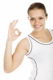 Young smiling girl showing OK sign Stock Images