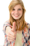 Young smiling girl showing thumbs up Stock Image