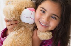Young smiling girl with stuffed toy Royalty Free Stock Photography