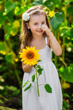Young smiling girl with sunflower Stock Photo