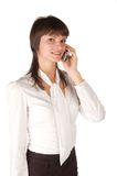 Young smiling girl  talks by mobile phone. Royalty Free Stock Photo