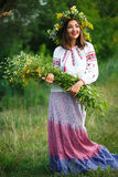 Young smiling girl in Ukrainian costume with a wreath on his hea Stock Image