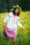 Young smiling girl in Ukrainian costume with a wreath on his hea Royalty Free Stock Photo