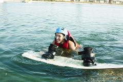 Young smiling girl on wake board in water, happy lifestyle people on vacations. Closeup royalty free stock photo