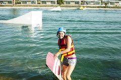 Young smiling girl on wake board in water, happy lifestyle people on vacations. Closeup stock images