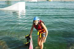 Young smiling girl on wake board in water, happy lifestyle people on vacations. Closeup royalty free stock photos