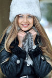 Young smiling girl winter portrait Royalty Free Stock Images