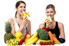 Young smiling girls eating banana Stock Image