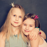 Young smiling girls hugging Royalty Free Stock Images