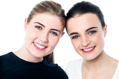 Young smiling girls looking at you Stock Photo