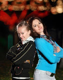 Young smiling girls in the night park Royalty Free Stock Photography