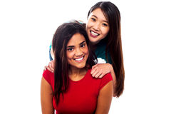 Young smiling girls posing for the camera Stock Images
