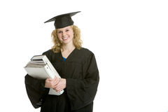 Young smiling graduation girl holding books. With white background Royalty Free Stock Photos