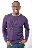 Young smiling guy in casual attire. Casual young man posing, hands in pockets Royalty Free Stock Photos
