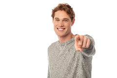 Young smiling guy pointing you out Stock Image