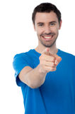 Young smiling guy pointing you out Royalty Free Stock Image