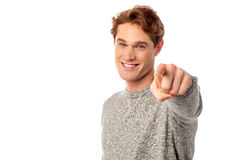Young smiling guy pointing you out Stock Photo