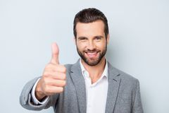 Young smiling handsome worker in formal clothing demonstrating t Royalty Free Stock Photos