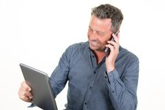 Free Young Smiling Happy Caucasian Man Using Tablet And Calling In Cell Phone Isolated On White Studio Background Royalty Free Stock Photography - 179130647