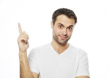 Young smiling happy man shows something Stock Photography