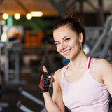 Young smiling happy woman in a fitness center Stock Image