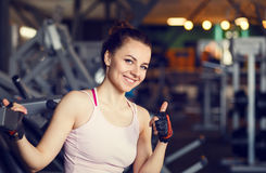 Young smiling happy woman in a fitness center Stock Images