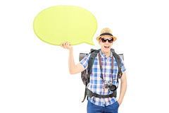 Young smiling hiker holding an empty speech bubble Stock Photography