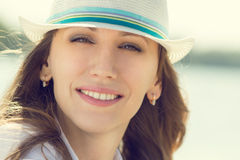 Young smiling hipster woman at summer vacation. Royalty Free Stock Photo