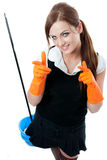 Young smiling housemaid Royalty Free Stock Photos
