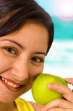 Young Smiling Lady At The Beach Holding An Apple. Which She Is Ready To Eat stock images