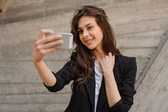 Young smiling  lady doing selfie Stock Images