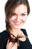 Young smiling lady touching hair isolated on white Royalty Free Stock Images