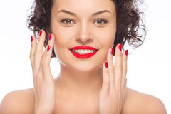 Young smiling lady upholding hands Royalty Free Stock Photography