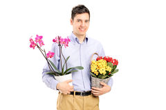A young smiling male holding flowers. Isolated on white background Stock Photo